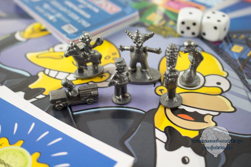 Gesellschaftsspiele-Monopoly-simpsons-Spielfiguren